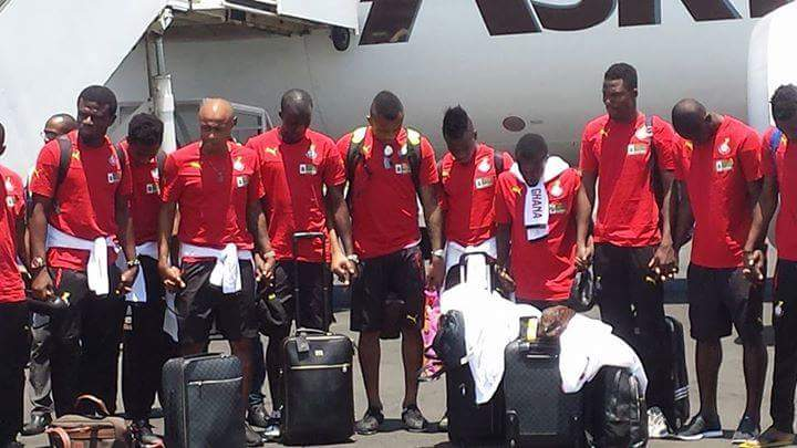 Black Stars pray after touching down in Moroni