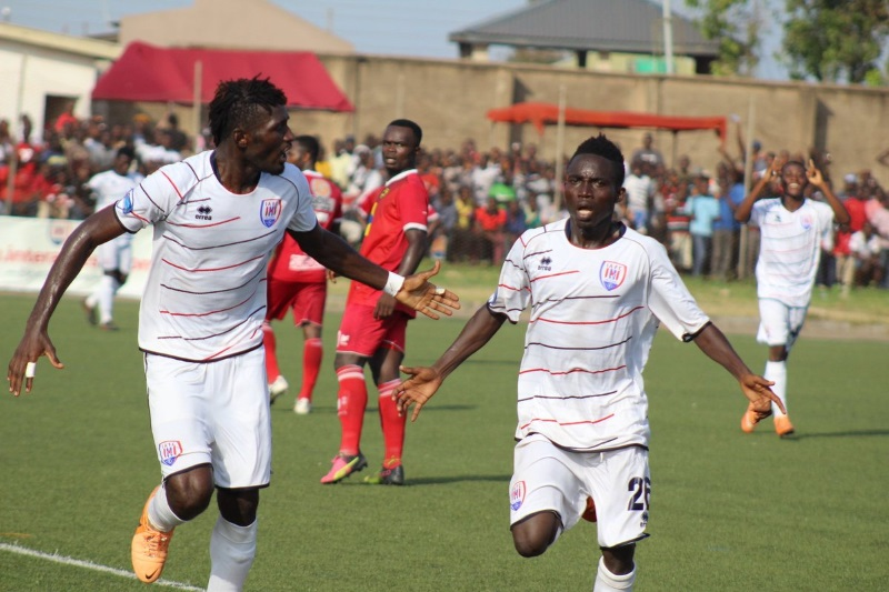 Opoku Yamoah (right) celebrates his 30-yard stunner
